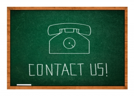 rasa: Contact us icon withe vintage telephone on green chalkboard with wooden frame. Stock Photo