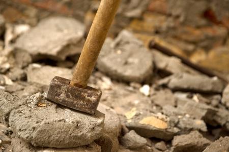 demolition: Hammer for breaking concrete, house interior redecoration detail.