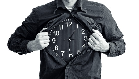 ripping shirt: Man ripping shirt and showing clock in place of his chest.