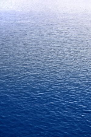 Blue water surface with brightness in the distance Stock Photo - 20560291