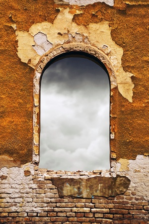incertitude: Dark clouds through an old obsolete window  Stock Photo