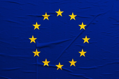 overlaying: Grunge blue Europian Union flag with yellow stars overlaying a grungy texture