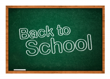 first day: back to school on a green classoom chalkboard