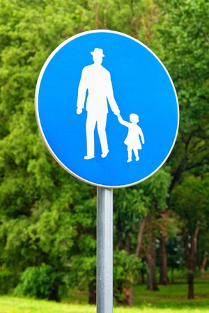 pedestrian walkway: Pedestrian walkway road sign  Illustration of old man holding little girl by the hand  Stock Photo