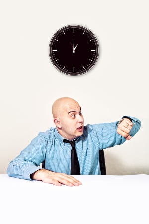 rushing hour: Businessman is late for a meeting Checking time on wrist watch  Stock Photo