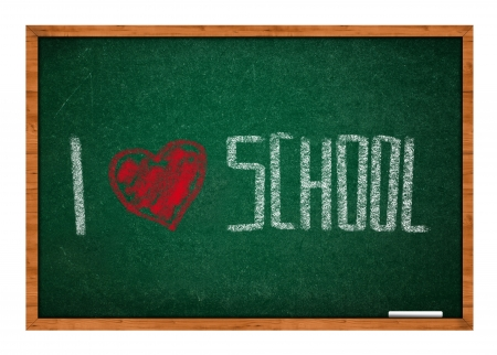 rasa: I love school message on green chalkboard with wooden frame.