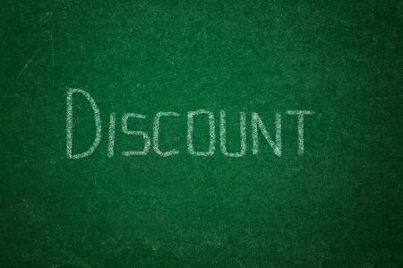 rasa: Word DICOUNT on green chalkboard background