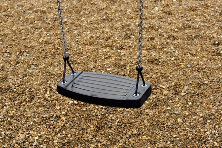 Empty playground swing in a empty park  photo