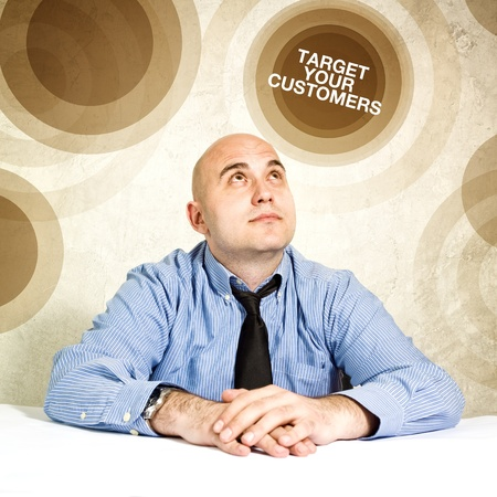 Target your customers; business concept  Businessman looking up  photo