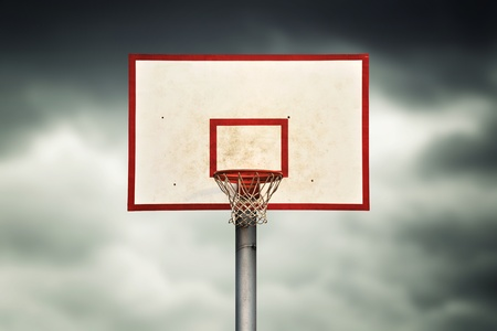 Basketball hoop and cage against dark sky Stock Photo