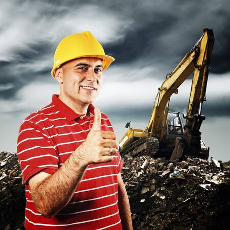 earth moving: Construction worker and excavator machine. Thumb up for earth moving. Stock Photo