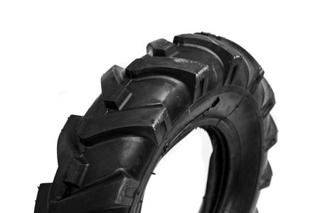 unused: New, unused black cultivator tyres. Agriculture and farming background image. Stock Photo