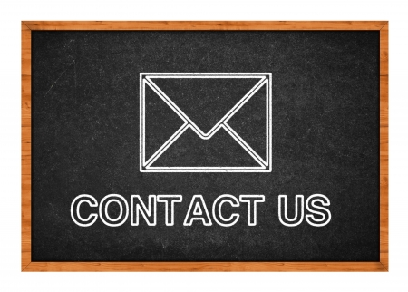 Contact us, drawing of an envelope on a black chalkboard. Stock Photo - 21569397