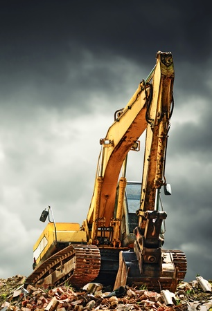 earth moving: EXcavator machine on construction site during earth moving works