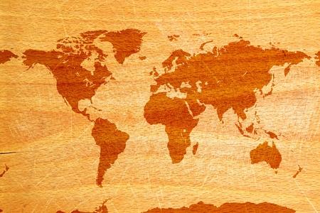 worldmap: World map on wooden grunge textured background Stock Photo