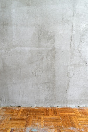 placement: Old room interior with gray concrete wall for product placement.