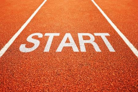 athlete running: Start on athletics all weather running track
