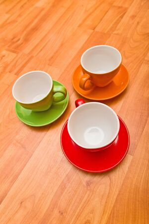 cusp: Coffee cup set on wooden background Stock Photo