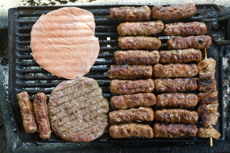 grilled meat on the barbeque plate, close up image photo