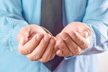 beggary: Businessman asking for money. Businessman begging with his cupped hands.