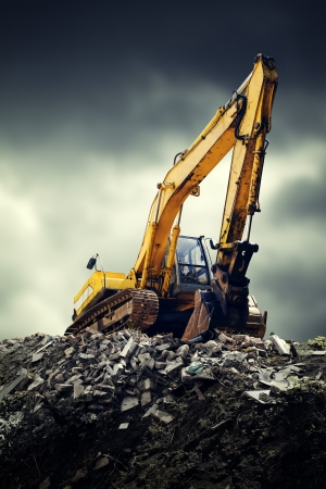 earthmover: EXcavator machine on construction site during earth moving works