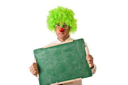 Clown holding chalkboard on white background Stock Photo