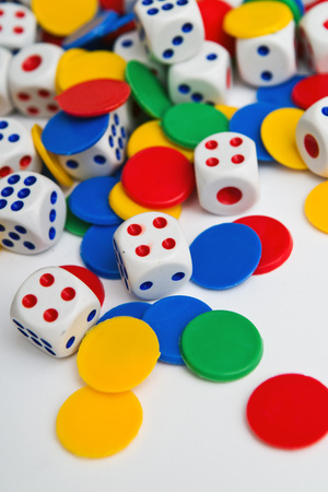 games of chance: Dice  Plastic dice pile as board game or gambling concept  Stock Photo