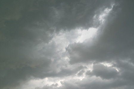 Heavy gray storm clouds bringing the cold winter rain photo