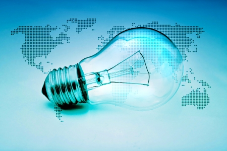 classic light bulb: light bulb. Classic light bulb on blue background with world map.