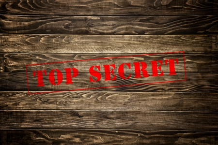 Top secret stamp on wood texture background photo