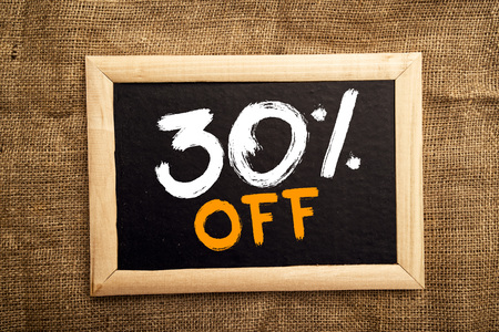 thirty percent off: Thirty percent off, discount tag on blackboard. Stock Photo
