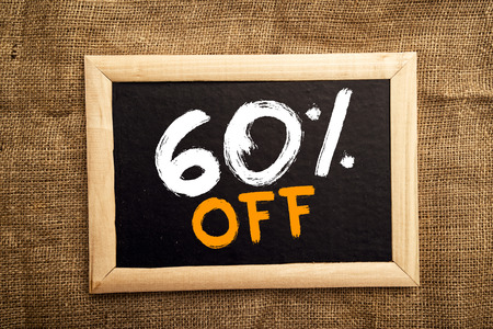 sixty: Sixty percent off, discount tag on blackboard.