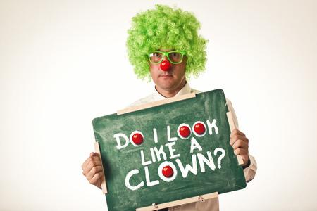 Clown holding chalkboard on white background. photo