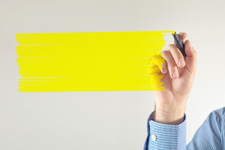 marker pen: Businessman writing note with yellow marker pen. Copy space for your message.