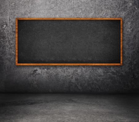 rasa: Concrete room interior with empty black board. Stock Photo
