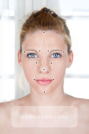 Face detection software recognizing a face of beautiful young woman photo