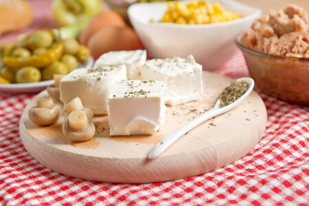 feta cheese: feta cheese with mushrooms on a kitchen table  Stock Photo