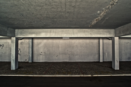 carpark: Public garage detail with grunge concrete walls. Stock Photo