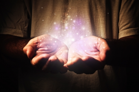 hands cupped: Cupped hands holding magic particles. Open hands of a man. Holding, giving, reaching, taking concept.