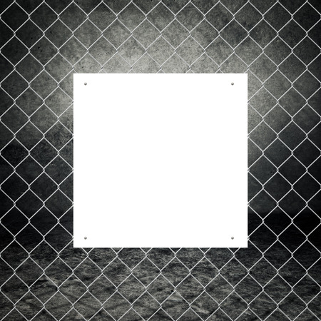 Blank poster on metal chain grid fence of concrete room