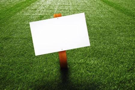 yard sign: Blank wooden sign on green lawn for your message. Stock Photo