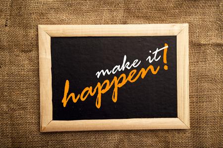make belief: make it happen, motivational messsage on blackbaord  Stock Photo