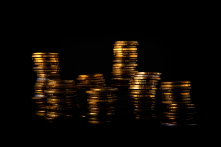 coin stack: Golden coin stack on dark background, money saving concept.