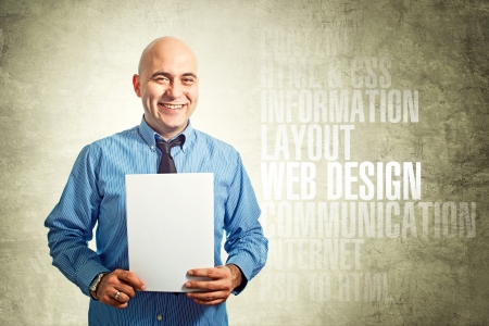 Web designer holding paper  Smiling business man with blank white poster  photo