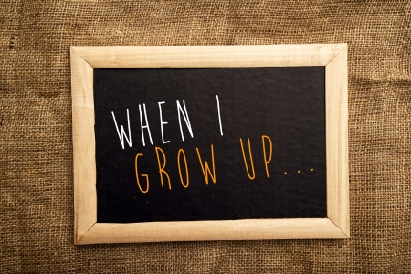When I grow Up note on black message board