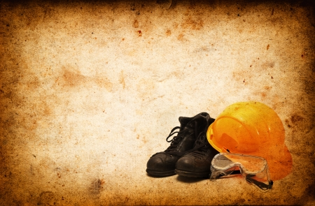safety boots: Safety equipment for construction industry on Vintage grunge old paper Stock Photo