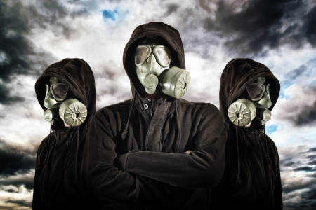 Gas mask soldiers over heavy storm clouds in background.