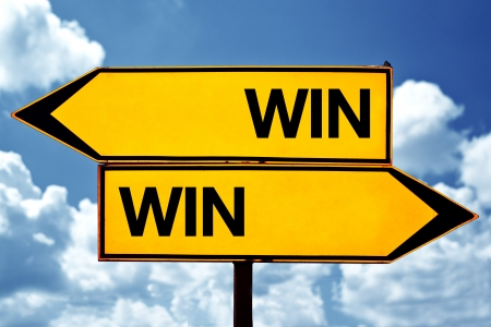 situation: Win-win situation, opposite signs  Two opposite signs against blue sky background