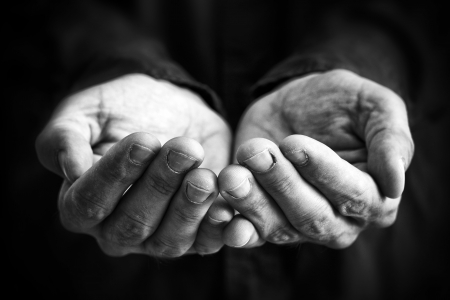 homeless: Cupped hands of a man hopefully held up. Cupped hands asking for something.