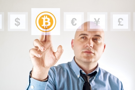 coins: Choosing bitoins as currency over other, businessman pressing touch screen button.